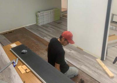Danny Skookum installing new flooring.