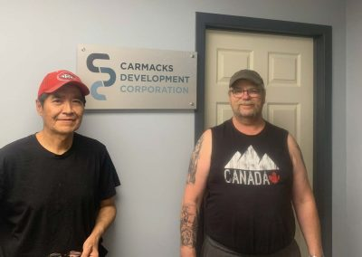 CDC workers Danny Skookum and Rob Cochrane installing the new office sign.